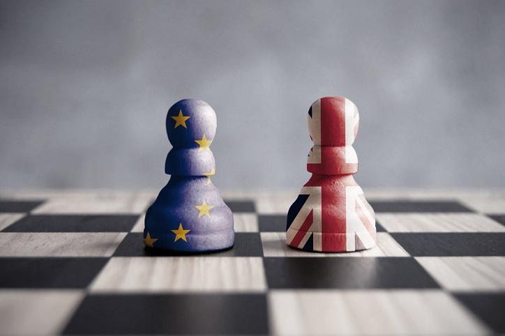 Brexit strategy concept showing two chess pawns with UK and European flags
