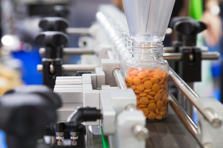 pharmaceutical industry, medicine pills are filling in the plastic bottle on production line machine conveyor at the medical factory SCAIR blog
