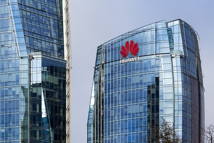 Three modern office buildings with Huawei logos in Vilnius