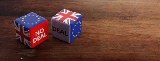 Brexit, deal or no deal concept. United Kingdom and European Union flags on dice, wooden background for SCAIR blog.