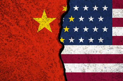 Closeup of a crack in USA and China flags. Trade war concept.