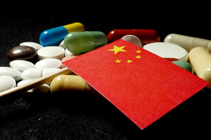 Chinese flag with lot of medical pills