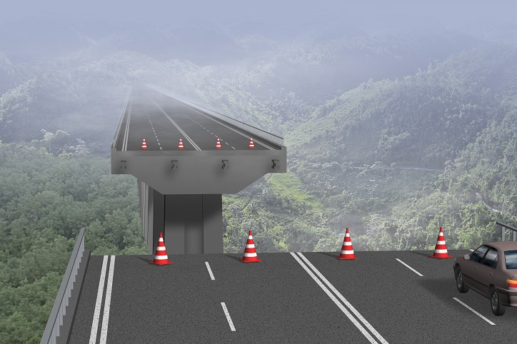 A raised highway with a gap and precipitious drop, representing business interruption insurance in the time of covid-19.